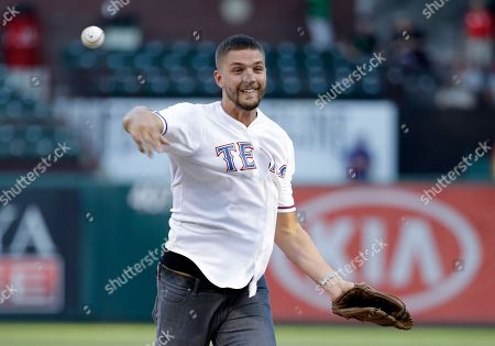 Chandler Parsons Dallas Mavericks' Chandler Parsons throws out the ceremonial first pitch before a baseball game between the Los Angeles Angels and Texas Rangers, in Arlington, Texas