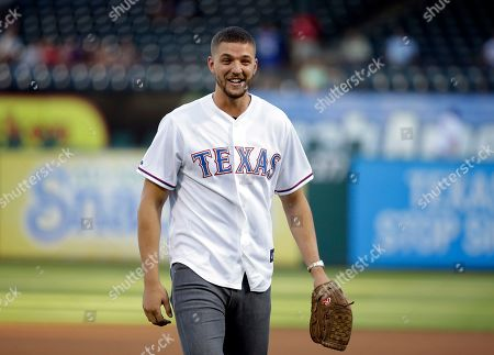 Chandler Parsons Dallas Mavericks' Chandler Parsons smiles after throwing out the ceremonial first pitch before a baseball game between the Los Angeles Angels and Texas Rangers, in Arlington, Texas