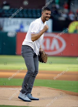 Chandler Parsons Dallas Mavericks' Chandler Parsons pumps his fist after throwing out the ceremonial first pitch before a baseball game between the Los Angeles Angels and Texas Rangers, in Arlington, Texas