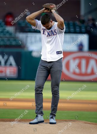 Chandler Parsons Dallas Mavericks' Chandler Parsons winds up to throw out the ceremonial first pitch before a baseball game between the Texas Rangers and Los Angeles Angels, in Arlington, Texas