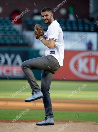 Chandler Parsons Dallas Mavericks' Chandler Parsons winds up before throwing out the ceremonial first pitch before a baseball game between the Los Angeles Angels and Texas Rangers, in Arlington, Texas