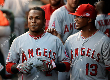Erick Aybar, Luis Jimenez Los Angeles Angels' Erick Aybar, left, is congratulated in the dugout by Luis Jimenez (13) following Aybar's two run home run that came off a pitch from Texas Rangers' Nick Martinez in the second inning of a baseball game, in Arlington, Texas. The home run scored Howie Kendrick