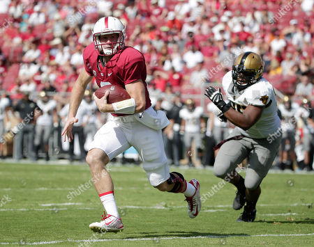 Stock Picture of Kevin Hogan, Richard Glover Stanford quarterback Kevin Hogan, left, is chased by Army defensive lineman Richard Glover during the first half of an NCAA college football game, in Stanford, Calif