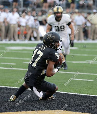 EJ Scott Wake Forest's E.J. Scott (17) catches a touchdown pass against Army during the second half of an NCAA college football game in Winston-Salem, N.C., . Wake Forest won 24-21