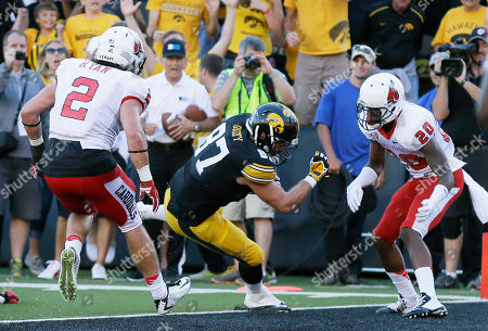 Stock Photo of Jake Duzey, Zack Ryan Iowa tight end Jake Duzey, center, catches a 12-yard touchdown pass between Ball State defenders Zack Ryan, left, and Darius Conaway, right, during the second half of an NCAA college football game, in Iowa City, Iowa. Iowa won 17-13