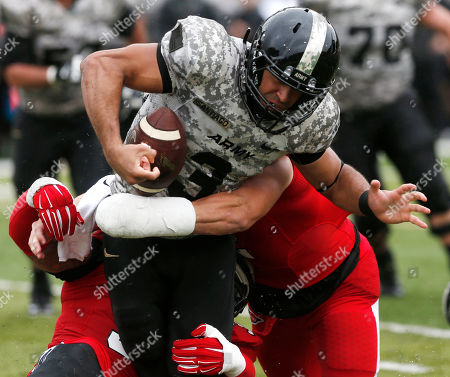 Stock Picture of Angel Santiago,Zack Ryan,Keenan Noel Army quarterback Angel Santiago (3) is sacked by Ball State defenders Keenan Noel and Zack Ryan during the second half of an NCAA college football game, in West Point, N.Y. Army won 33-24