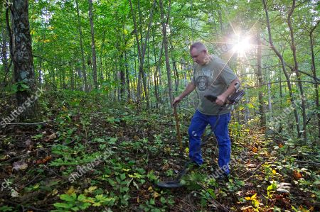 Kenny King Kenny King, 59, of Ethel, W.Va., scours the grounds of Blair Mountain, with a metal detector in Blair Mountain, W.Va. The Battle of Blair Mountain, a five-day skirmish between law enforcement and union miners in the coalfields of southern West Virginia, occurred here. Environmental groups, including the Sierra Club, have joined King in petitioning the National Register of Historic Places to declare Blair Mountain a historic landmark