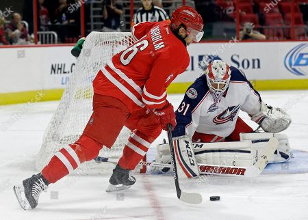 Elias Lindholm, Anton Forsberg Carolina Hurricanes' Elias Lindholm (16), of Sweden, is blocked by Columbus Blue Jackets goalie Anton Forsberg (31), of Sweden, during the first period of an NHL preseason hockey game in Raleigh, N.C