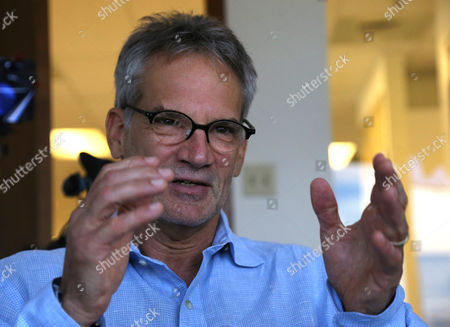 "Jon Krakauer Colorado-based author Jon Krakauer gestures during an interview with The Associated Press,, in Denver. Three years ago, ""60 Minutes"" and Krakauer alleged that Greg Mortenson, author of ""Three Cups of Tea"", fabricated much of the book and mismanaged the charity he co-founded, Central Asia Institute. The Central Asia Institute lost most of its donors, with contributions plummeting from a high of about $22 million in 2010 to $2.7 million last year"