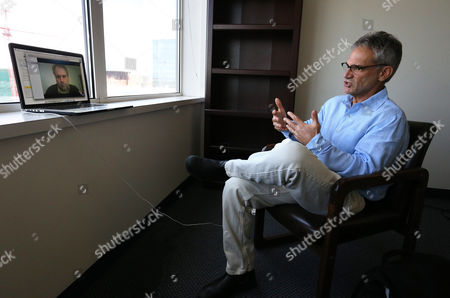 "Jon Krakauer Colorado-based author Jon Krakauer gestures during an interview via Skype with Associated Press Montana correspondent Matt Volz, left,, in Denver. Three years ago, ""60 Minutes"" and Krakauer alleged that Greg Mortenson, author of ""Three Cups of Tea"", fabricated much of the book and mismanaged the charity he co-founded, Central Asia Institute. The Central Asia Institute lost most of its donors, with contributions plummeting from a high of about $22 million in 2010 to $2.7 million last year"
