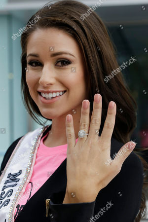 Nia Sanchez Nia Sanchez, Miss USA, displays her engagement ring for photographers before participating in an event for Breast Cancer Awareness Month, in New York. Sanchez was recently engaged to actor Daniel Booko
