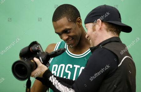 Stock Picture of Rajon Rondo Boston Celtics guard Rajon Rondo, left, and Boston Celtics team photographer Brian Babineau, right, look at an image of Rondo on the back of Babineau's camera during a photo shoot on team media day, in Waltham, Mass