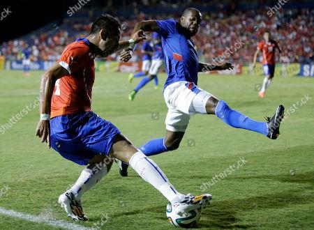Mauricio Isla, Kim Jaggy Chile's Mauricio Isla, left, kicks the ball as Haiti's Kim Jaggy, right, defends in the first half of an international friendly soccer match, in Fort Lauderdale, Fla