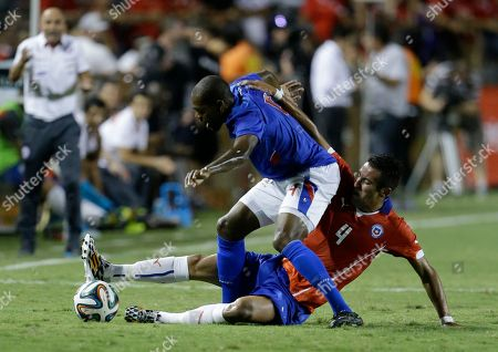 Kim Jaggy, Mauricio Isla Haiti's Kim Jaggy, left, and Chile's Mauricio Isla, right, go for the ball in the first half of an international friendly soccer match, in Fort Lauderdale, Fla