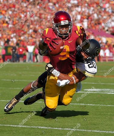 JuJu Smith, Greg Henderson Southern California wide receiver JuJu Smith, top, reaches over the line for a touchdown while being dragged down by Colorado cornerback Greg Henderson during first half of an NCAA college football game, in Los Angeles