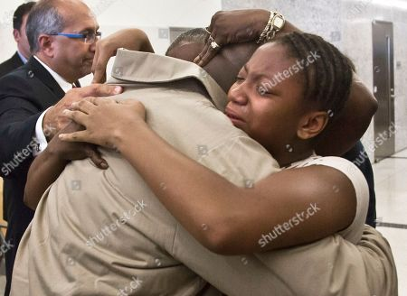 David McCallum, right, hugs family members after his exoneration at Brooklyn's Supreme Court on in New York. McCallum and Willie Stuckey, who died in prison, were 16 years old when they were convicted of murder. A judge exonerated both men for wrongful conviction after nearly 30 years