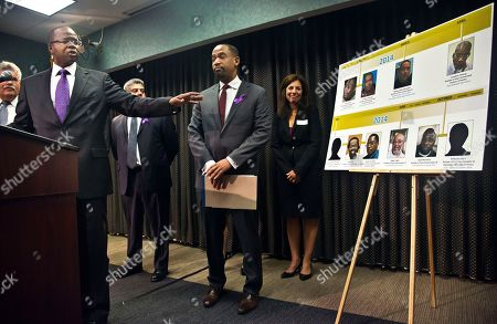 Brooklyn District Attorney Ken Thompson, left, points to time-line photo display of individuals exonerated in wrongful conviction cases, as he speaks during a press conference, in New York. Thompson said he will ask a judge to throw out the convictions of David McCallum and the late Willie Stuckey, saying their murder convictions hinged on made-up confessions peppered with details seemingly supplied by police
