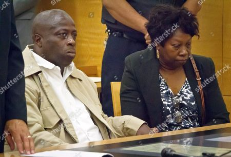 David McCallum, left, and Rosia Nealy, right, the mother of Willie Stuckey, listen to the remarks of a judge in Brooklyn's Supreme Court, in New York. McCallum and Stuckey, who died in prison, were 16 years old when they were convicted of murder. A judge exonerated both men for wrongful conviction