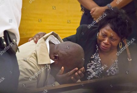 David McCallum, left, his comforted by Rosia Nealy, the mother of Willie Stuckey, as he weeps after his exoneration, in New York. McCallum and Stuckey, who died in prison, were 16 years old when they were convicted of murder. A judge exonerated both men for wrongful conviction