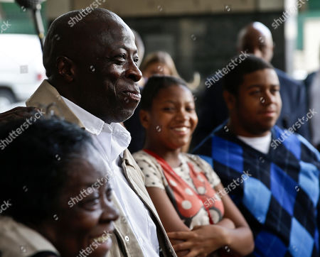 David McCallum, second from left, stands with his immediate family outside Supreme Court on in New York. A judge exonerated McCallum, and Wille Stuckey, who died in prison, of wrongful imprisonment for murder after nearly 30 years