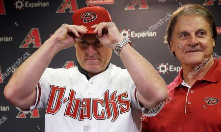 Chip Hale, Dave Stewart, Tony LaRussa New Arizona Diamondbacks baseball team manager Chip Hale, left, puts on a Diamondbacks hat as he is introduced by chief baseball officer Tony LaRussa at a news conference in Phoenix. As position players report to spring training for the Diamondbacks, competition looms for a spot in the opening day lineup under new manager Chip Hale