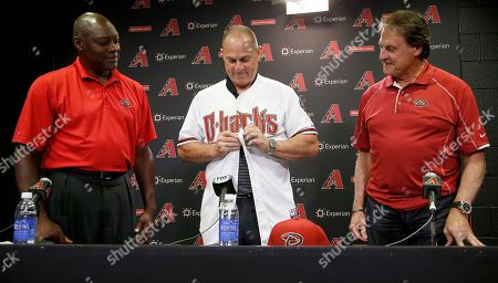 Chip Hale, Dave Stewart, Tony LaRussa Arizona Diamondbacks baseball team new manager Chip Hale, middle, puts on a Diamondbacks jersey as he is introduced by general manager Dave Stewart, left, and chief baseball officer Tony LaRussa during a news conference, in Phoenix. The former Diamondbacks third base coach was hired Monday to replace fired Kirk Gibson as the Diamondbacks manager. The 49-year-old managed in Arizona's minor league system for six seasons and was with the Diamondbacks from 2007-09 in the first of eight consecutive seasons as a big league third base coach