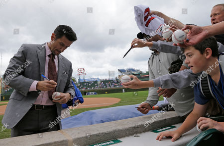 Nomar Garciaparra Nomar Garciaparra autographs for fans before a baseball game between the Chicago Cubs and the Los Angeles Dodgers in Chicago