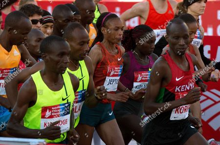 Rita Jeptoo Elite runners including Kenya's Eliud Kipchoge, left, and Rita Jeptoo, center, depart from the starting line during the Chicago Marathon, in Chicago. Athletics Kenya said on Friday, Jan. 30, 2015 that it has banned marathon champion Rita Jeptoo two years for doping after traces of the banned blood-booster EPO were found in her out-of-competition test in Kenya on Sept. 25