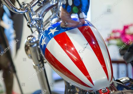 "The ""Easy Rider"" Captain America Harley-Davidson with its gas tank autographed by actor Peter Fonda displayed in Calabasas, Calif. The Profiles in History auction house estimates the restored Harley-Davidson will bring a minimum of $1 million at its Oct. 18, 2014 sale. Its principal authentication comes from ""Grizzly Adams"" actor Dan Haggerty, who had a bit part in ""Easy Rider"" and claims to have taken possession of the only bike that survived the filming of the druggy road movie. But Haggerty admitted this week, in an interview with Los Angeles Times, that he has authenticated and sold two Captain America bikes"