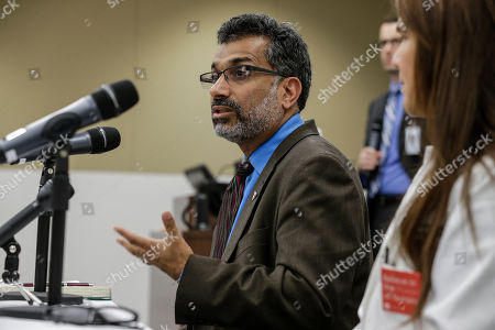 Ali Khan, Rosanna Morris Dr. Ali Khan, Dean of the College of Public Health at the Nebraska Medical Center, speaks during a news conference in Omaha, Neb., to discuss Ebola patient, journalist Ashoka Mukpo, who is expected to arrive from Liberia at the Medical Center on Monday