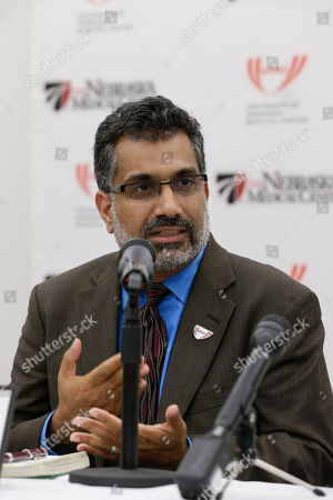 Ali Khan Dr. Ali Khan, Dean of the College of Public Health at the Nebraska Medical Center, speaks during a news conference in Omaha, Neb., to discuss Ebola patient, journalist Ashoka Mukpo, who is expected to arrive from Liberia at the Medical Center on Monday