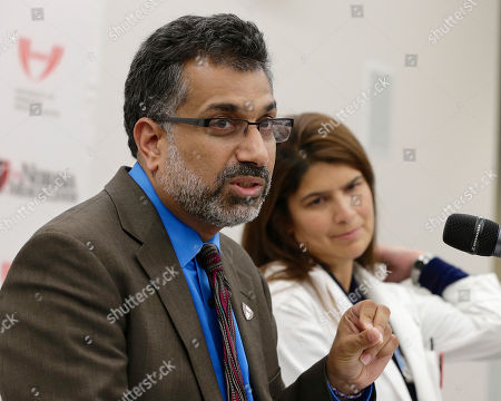 Ali Khan, Rosanna Morris Dr. Ali Khan, left, Dean of the College of Public Health at the Nebraska Medical Center speaks during a news conference in Omaha, Neb., to discuss Ebola patient, journalist Ashoka Mukpo, who is expected to arrive from Liberia at the Medical Center on Monday. Rosanna Morris, Chief Nursing officer, listens at right