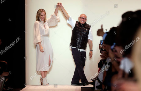 Stock Image of Max Azria, Luba Azria Designer Max Azria and his wife Luba Azria acknowledge audience applause after their BCBG MAX AZRIA Spring 2015 collection was modeled during Fashion Week in New York