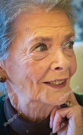 """Betty Halbreich Personal shopper Betty Halbreich, 86, poses at her office desk at Bergdorf Goodman in New York. She lays out her life in a new book, """"I'll Drink to That: A Life in Style with a Twist,"""" co-written by Rebecca Paley"""