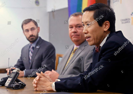 Joseph Thai, Ryan Kiesel, Scott Hamilton Attorney Joseph Thai, right, answers a question at a news conference in Oklahoma City, . From left are Ryan Kiesel of the ACLU, Scott Hamilton of the Cimarron Alliance and Thai. The U.S. Supreme court declined to hear appeals from several states seeking to ban same-sex marriage on Monday
