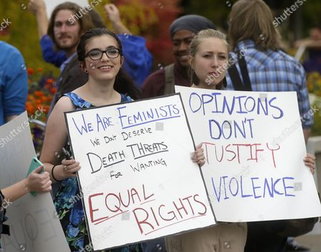 Mikaila Young, left, and Shannon Rigby, right, protest on the campus of Utah State, in Logan, Utah. Utah's campus gun laws are in the spotlight after feminist speaker Anita Sarkeesian canceled a speech at Utah State University once she learned the school would allow concealed firearms despite an anonymous threat against her. School officials in Logan were set to go ahead with the event with extra police after consulting with federal and state law enforcement who told them the threat was consistent with ones Sarkeesian receives when she gives speeches elsewhere