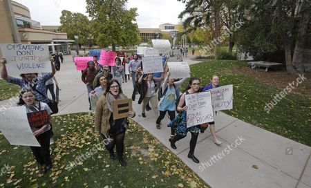Students protest on the campus of Utah State, in Logan, Utah. Utah's campus gun laws are in the spotlight after a feminist speaker canceled a speech at Utah State University once she learned the school would allow concealed firearms despite an anonymous threat against her. School officials in Logan were set to go ahead with the event with extra police after consulting with federal and state law enforcement who told them the threat was consistent with ones Anita Sarkeesian receives when she gives speeches elsewhere