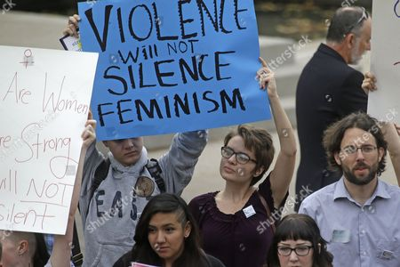 People protest on the campus of Utah State, in Logan, Utah. Utah's campus gun laws are in the spotlight after a feminist speaker canceled a speech at Utah State University once she learned the school would allow concealed firearms despite an anonymous threat against her. School officials in Logan were set to go ahead with the event with extra police after consulting with federal and state law enforcement who told them the threat was consistent with ones Anita Sarkeesian receives when she gives speeches elsewhere