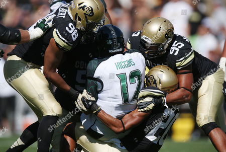 Jeremy Higgins, Jimmie Gilbert, Derek McCartney, Greg Henderson Hawaii quarterback Jeremy Higgins, center, is sacked for a loss of yards by, from left, Colorado defensive linemen Jimmie Gilbert, Derek McCartney and defensive back Greg Henderson in the fourth quarter of an NCAA college football game in Boulder, Colo., on