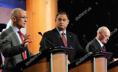 Republican seeking the party nomination for the Congress, former U.S. Rep. Frank Guinta, center and former Seabrook selectman Brendan Kelly, right listen to University of New Hampshire administrator Dan Innis during a televised debate at WMUR in Manchester, N.H. The winner of the state's Sept. 9 primary will face Democratic incumbent Carol Shea-Porter