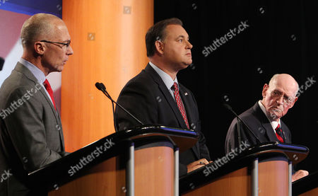 Republican seeking the party nomination for the Congress, former U.S. Rep. Frank Guinta, center and former Seabrook selectman Brendan Kelly, right listen to University of New Hampshire administrator Dan Innis during a televised debate at WMUR in Manchester, N.H. The winner of the state's Sept. 9 primary will face incumbent Carol Shea-Porter