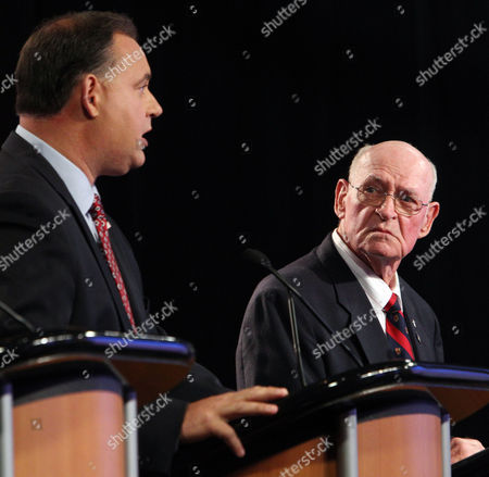 Republicans seeking the party nomination for the Congress, former Seabrook selectman Brendan Kelly, right listens to forrmer U.S. Rep. Frank Guinta, during a televised debate at WMUR in Manchester, N.H. The winner of the state's Sept. 9 primary will face Democratic incumbent Carol Shea-Porter