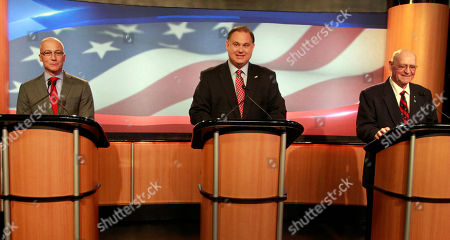 Republicans competing for a chance to take on U.S. Rep. Carol Shea-Porter in November, from left, University of New Hampshire administrator Dan Innis, former U.S. Rep. Frank Guinta, and former Seabrook selectman Brendan Kelly get ready for a televised debate at WMUR in Manchester, N.H