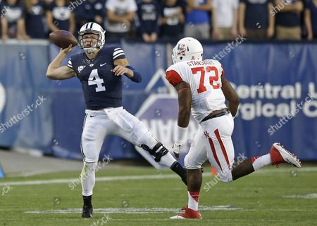 Taysom Hill, Gavin Stansbury Brigham Young quarterback Taysom Hill (4) passes the ball as Houston defensive end Gavin Stansbury (72) defends in the first quarter during an NCAA college football game, in Provo, Utah