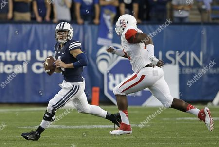 Taysom Hill, Gavin Stansbury Brigham Young quarterback Taysom Hill (4) runs as Houston defensive end Gavin Stansbury (72) pursues in the first quarter during an NCAA college football game, in Provo, Utah