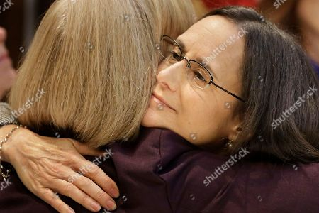 Attorney General Lisa Madigan, right, hugs Mary Kay Mace, the mother of a Northern Illinois University shooting victim, after holding a news conference on the Crime Victims' Bill of Rights, also known as Marsy's Law for Illinois, in Springfield, Ill. When Illinois voters cast ballots this year, they won't just get a chance to weigh in on a nationally watched governor's race. They also will have to wade through a record five ballot questions ranging from proposed constitutional amendments on voter rights and victim rights to poll-style referendum questions on birth control, a minimum wage hike and a proposed new tax on millionaires