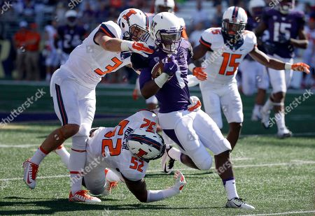 John Ross, Taylor Barton Washington wide receiver John Ross, center, is tackled by Illinois defensive back Taylor Barton (3) and linebacker T.J. Neal Jr. (52) in the first half of an NCAA college football game, in Seattle
