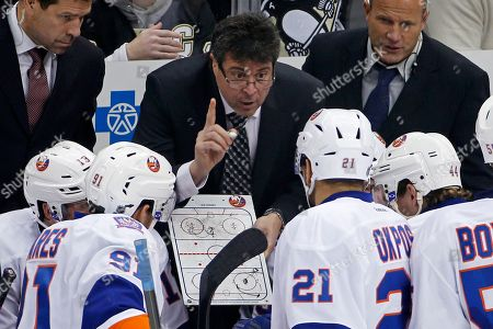 Doug Weight, Jack Capuano, Greg Cronin New York Islanders head coach head coach Jack Capuano, center, gives instructions as assistant coaches Doug Weight, left, and Greg Cronin, right, listen during the third period of an NHL hockey game against the Pittsburgh Penguins in Pittsburgh, . The Penguins won 3-1