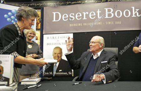 """Jon Huntsman, Sr Jon Huntsman, Sr. waves after signing a book during a book signing at Deseret Books, in Salt Lake City. Industrialist and philanthropist Huntsman Sr. released a new autobiography about his life. At a news conference Friday, Huntsman Sr. talked about the book, which tells his life story in his own words and his titled, """"Barefoot to Billionaire; Reflections on a Life's Work and a Promise to Cure Cancer"""