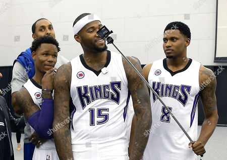 """Stock Image of Ryan Hollins, Ben McLemore, DeMarcus Cousins, Rudy Gay Sacramento Kings center DeMarcus Cousins, center, leans into the camera as he and teammates Ryan Hollins, background left, Ben McLemore, second from left, and Rudy Gay, right, take a """"selfie"""" during the Kings basketball media day in Sacramento, Calif"""